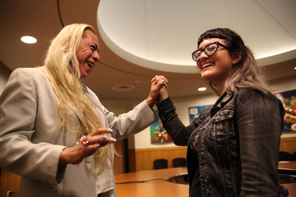 Bamby Salcedo entwines hands with Deziree Miller after Q&A with actvist in the ROMC Reading Room on Thursday, Oct. 30, 2014.