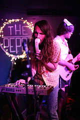 Shahan Salim of Banshee Boardwalk sings into a telephone-mic at The Depot on Thursday, Oct. 30, 2014. Ryan Leibrich / Xpress