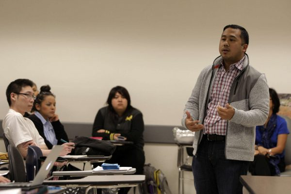 Eric Pido, Ph. D. assistant professor in the Asian-American studies department, shares experiences he has been through during the Violence Teach-In hosted at SF State Tuesday, Nov. 4, 2014. Daniel Porter/Xpress.