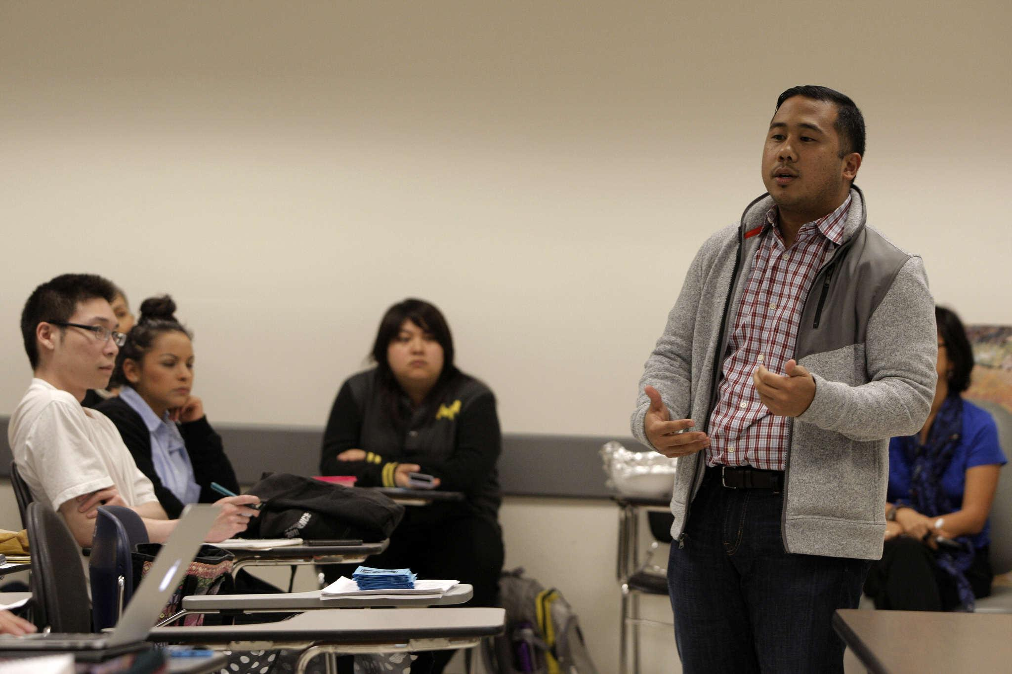 Eric Pido, Ph. D. assistant professor in the Asian-American studies department, shares experiences he has been through during the Violence Teach-In hosted at SF State Tuesday, Nov. 4, 2014.
