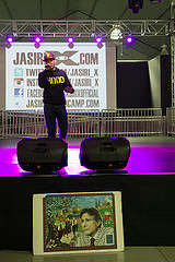 Rapper Jasiri X introduces himself onstage, with the image of Edward Said's mural in the foreground, before his performance at the 7th Annual Edward Said Mural Celebration in the SF State Student Event Center Wednesday, Nov. 5, 2014. Eric Gorman/Xpress.