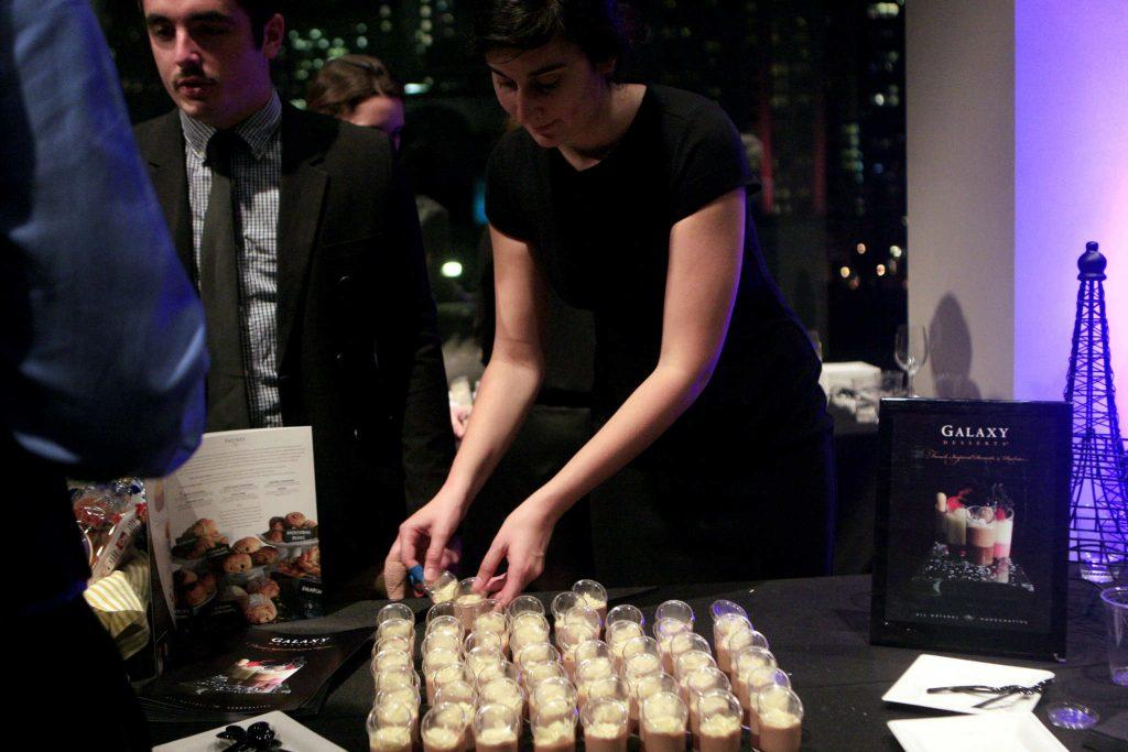 Yasmine Curmi, R and D for Galaxy Deserts, straightens the sample deserts for the guests at the Taste of the Bay event presented by the hospitality and tourism department at the City View on top of the Metreon in San Francisco, Calif., Wednesday, Nov. 12, 2014. Daniel Porter/Xpress.