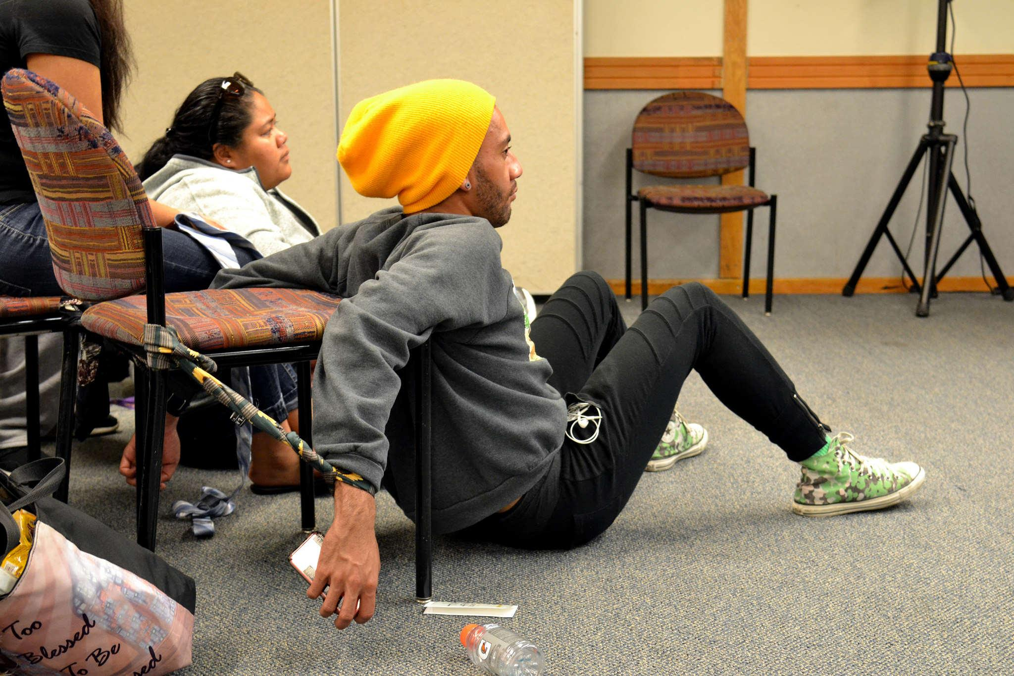 Spulu, a dance major, watches the workshop while still tied to his chair with neckties Wednesday, Oct. 29, 2014.