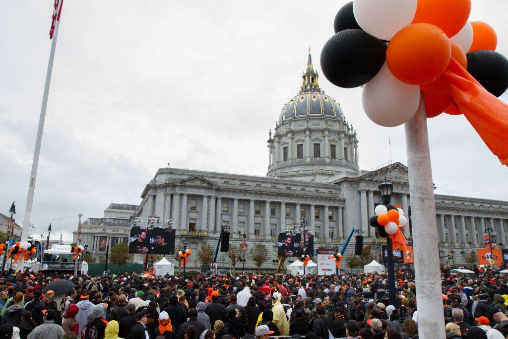 San Francisco Giants fans celebrate their 2014 World Series victory in the Civic Center Plaza outside of city hall Friday, Oct. 31, 2014.