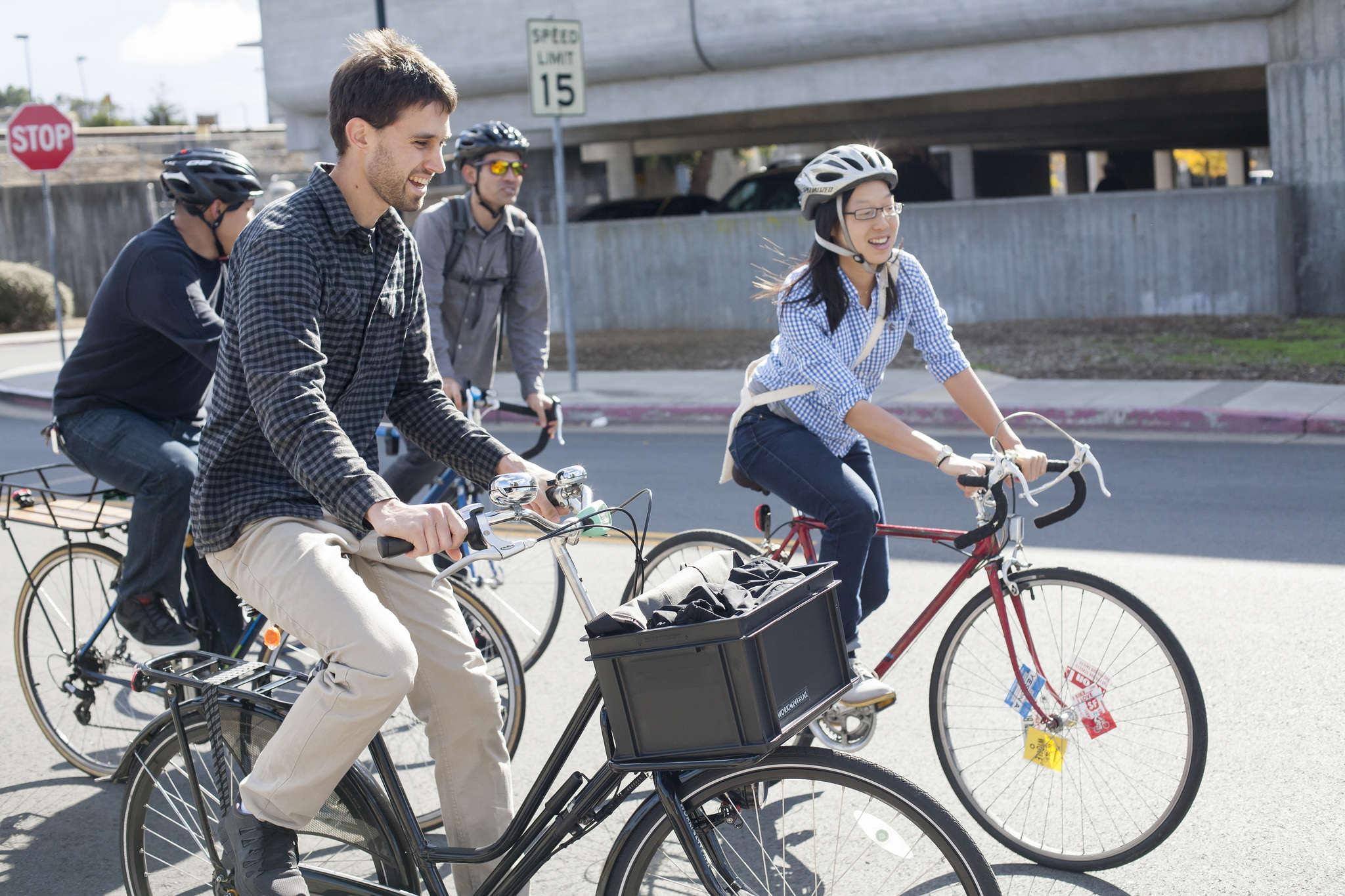 Mark Dreger (left) and Janice Li (right) taking biking to the first stop of prospective sites concerning cycling traffic by the San Francisco Municipal Transportation Agency Saturday, Nov. 1, 2014.