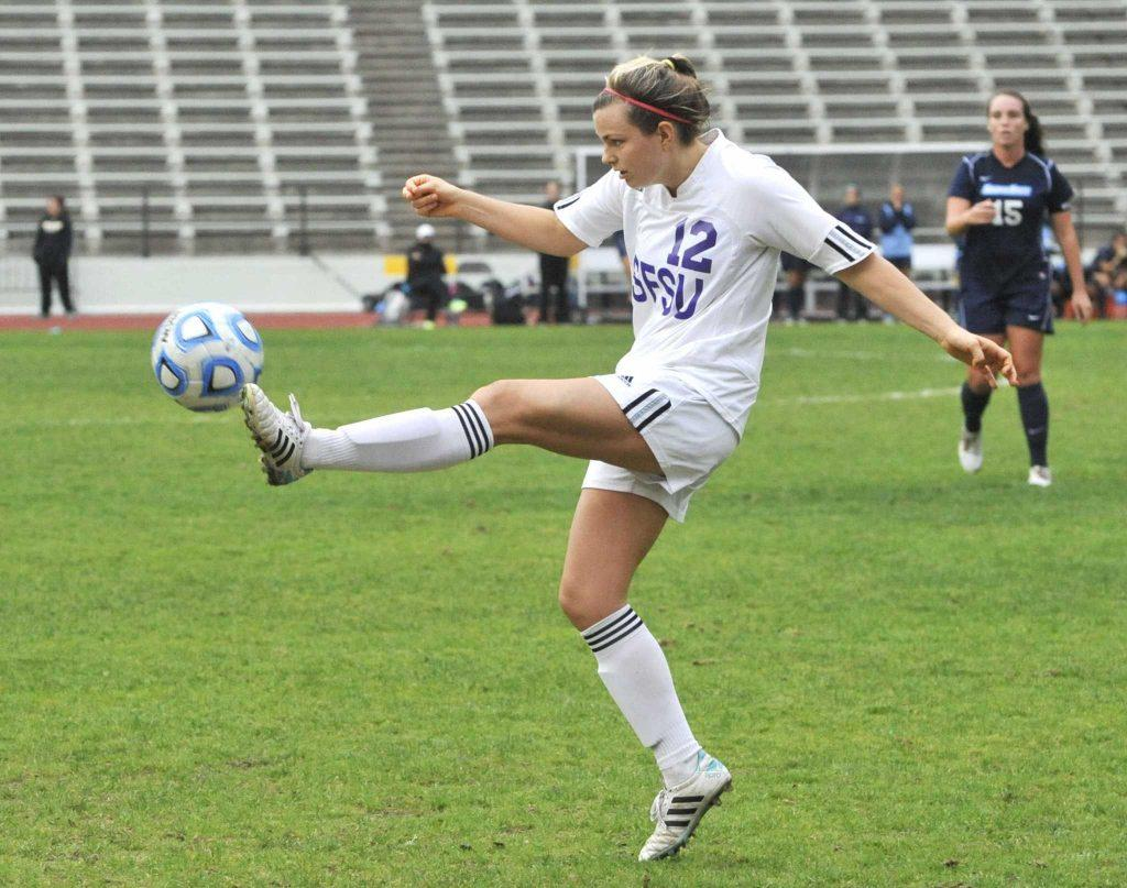SF State Gators player Graceann Rettig, #12, volleys the ball during a game agianst the Sonoma State Seawolves at Cox Stadium Thursday, Oct. 30, 2014. Sara Gobets/Xpress.
