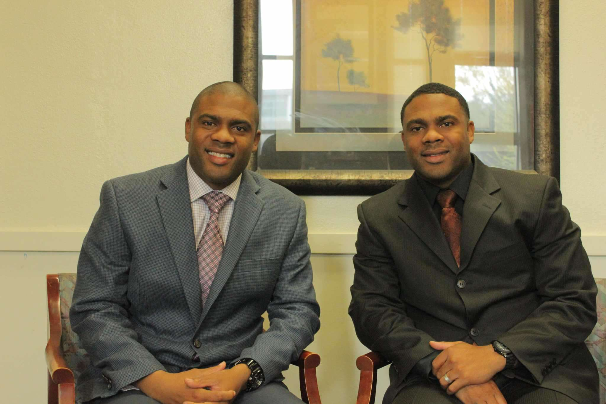 Twins, Ron, left, and Reggie Richardson sit for a portrait in Reggie's office at San Leandro High School, where they are co-principals Tuesday Nov. 18. Michael Duran/Xpress