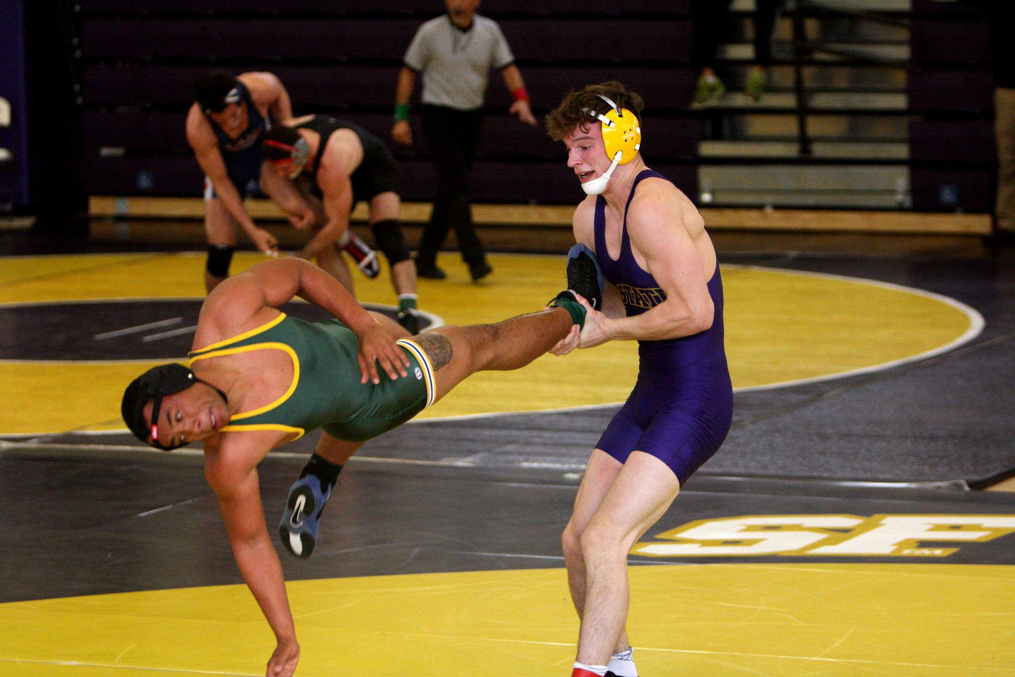 San Francisco State Gator Calvin Nicholls matches North Dakota State Thundar Joseph Garner during the California Collegiate Open at the San Francisco State Gymnasium on January 31 2014.