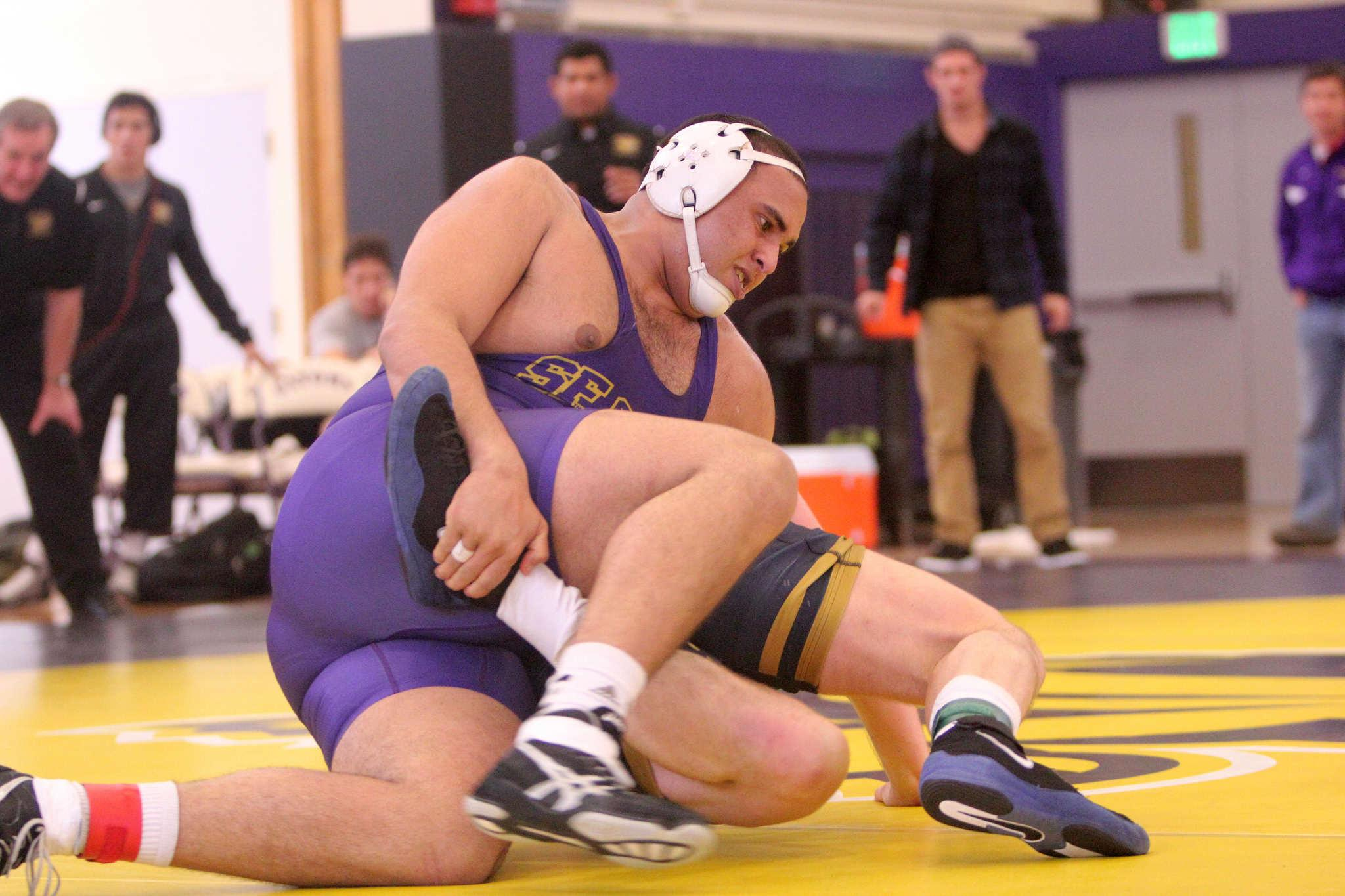 San Francisco State's Sam Alnassiri puts a leg hold on Cal Baptist's David Dill's at SF State's gym during the match Friday, Jan. 30. (Drake Newkirk / Xpress)