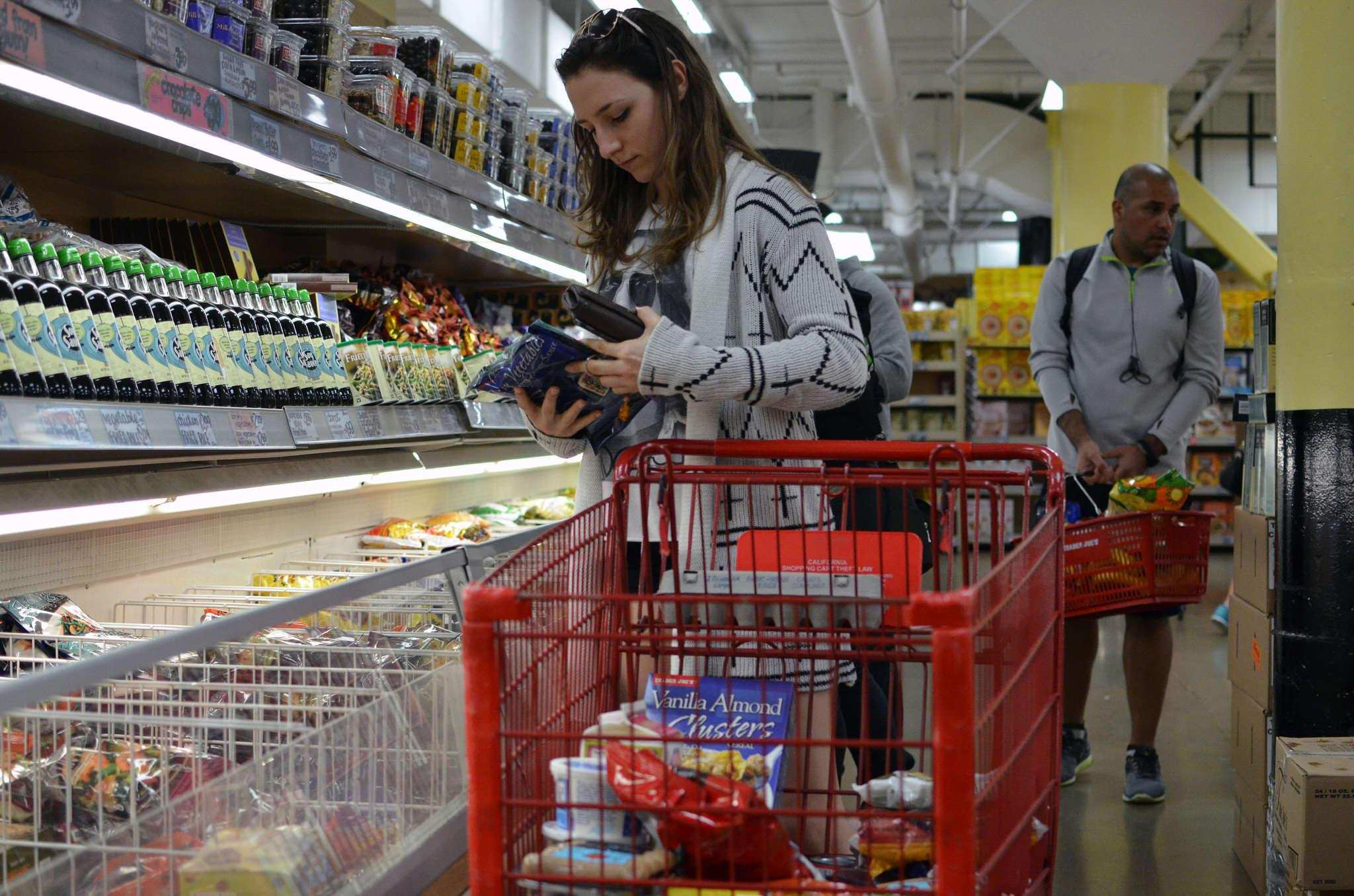 Marija Milutinavic does grocery shopping at Trader Joe's Sunday Feb, 1. (Photo by Hyunha Kim)