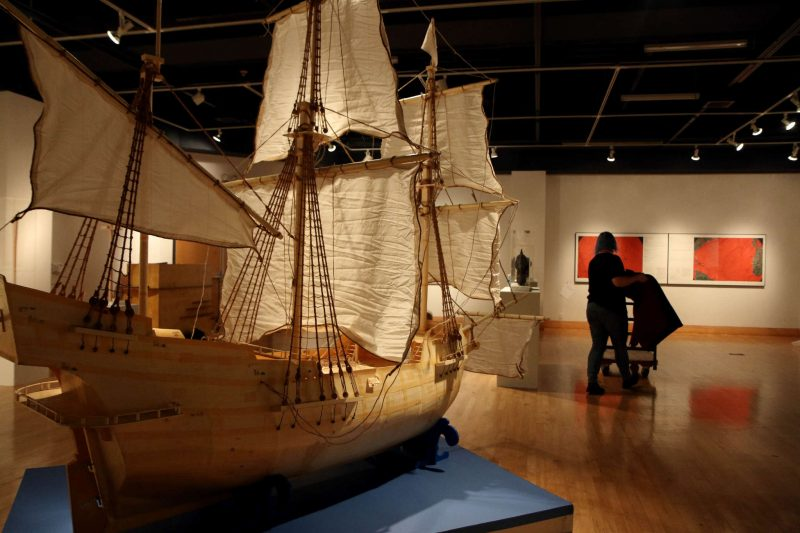 A pirate ship sits in the middle of the room while Emily Vanags, an Art History Major, prepares the Hydrarchy Gallery on Tuesday Feb. 17. (Marlene Sanchez / Xpress)