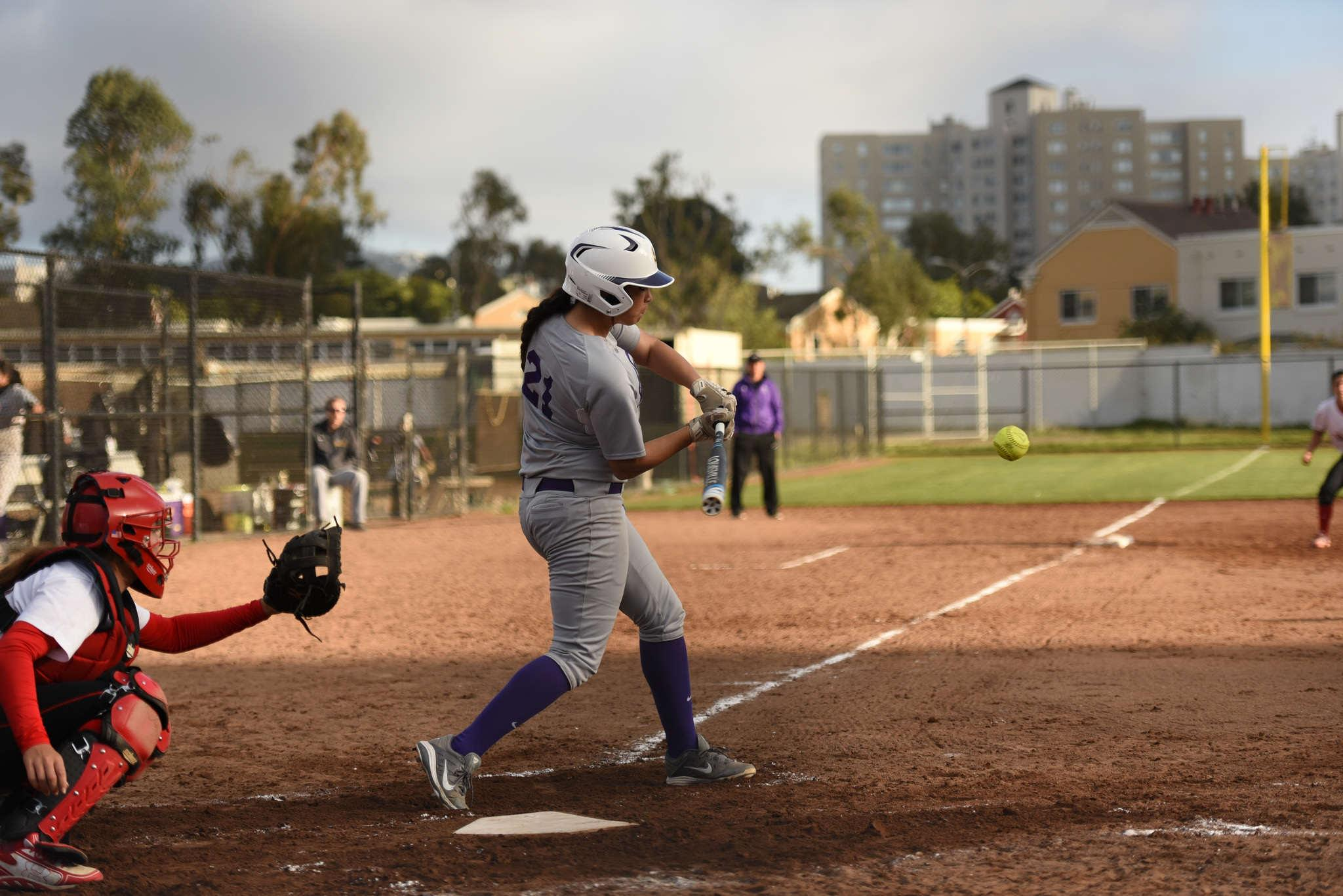 Freshman Sara Higa singles in game two of a doubleheader against The University of Hawaii at Hilo at SFSU Softball Stadium on Wednesday, Feb. 18, 2015. (David Henry / Xpress)