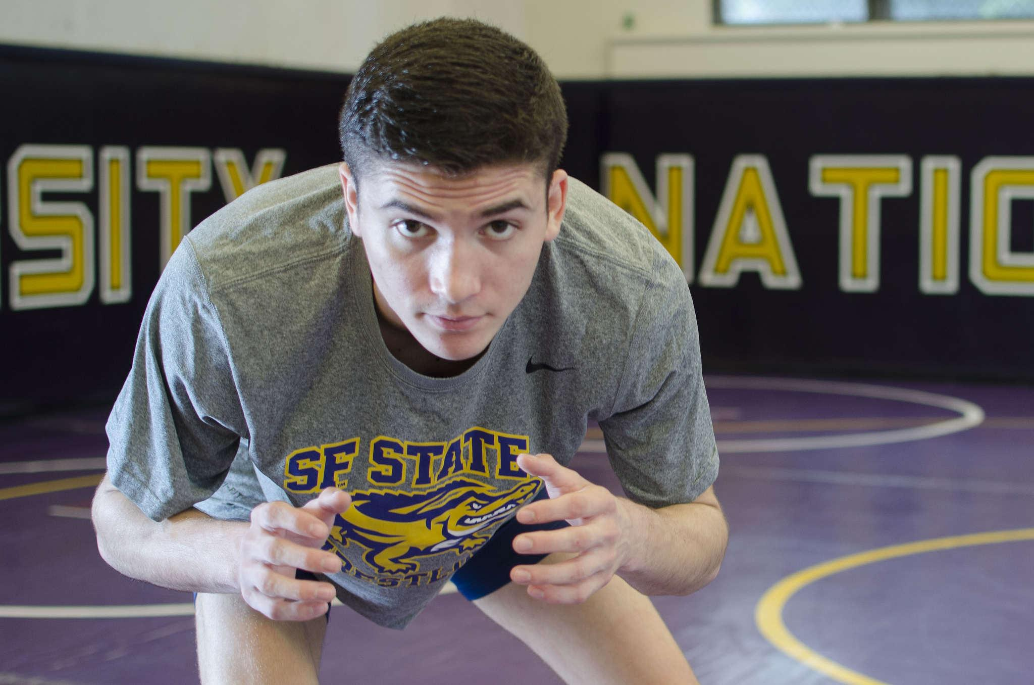 SF State's leading wrestler with a record of 25-9, Jordan Gurrola, stands on the mats in the gym on Monday Feb, 9.