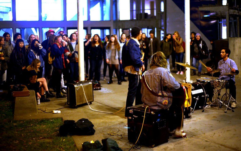 SF State students Andrew Harley, Trevor Ramirez and Alec Kersenboom freestyle a mix of jazz, soul, funk, and R&B in the Malcolm X Plaza at SF State after they performed at the open mic in the Depot on Thursday Feb 5, 2015. Photo by: Emma Chiang