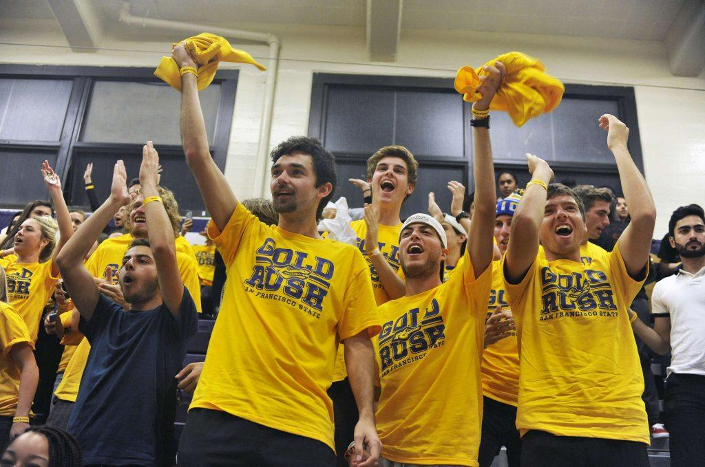 Excited SF State Gator basketball fans sport Gold Rush T-shirts and cheer on the team during a game against UC San Diego on Friday, Feb. 13, 2015.