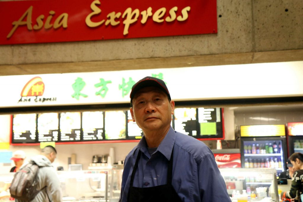 Frank Meng stands in front of Asia Express in the Cesar Chavez Student Center on Tuesday Feb. 17. (Marlene Sanchez / Xpress)