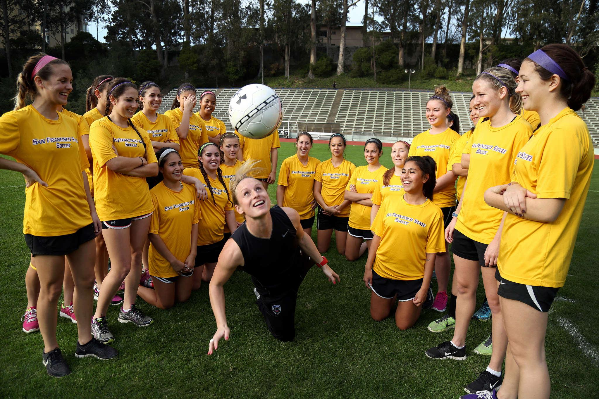 Tracy Hamm, SF State's new Head Women's Soccer Coach is the second in the 33-years, succeeding Jack Hyde. Hamm juggles with the ball surrounding the team at Cox Stadium on Monday Feb. 2, 2015. (Emma Chiang/Xpress)