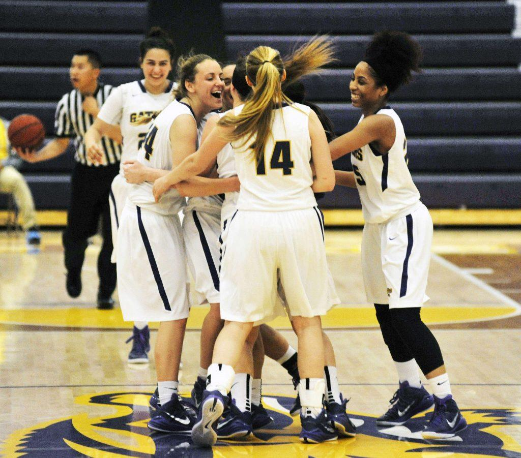 The SF State Gators celebrate after winning their last home game of the season against the Chico State Wildcats on Feb. 21, 2015. (Sara Gobets / Xpress)