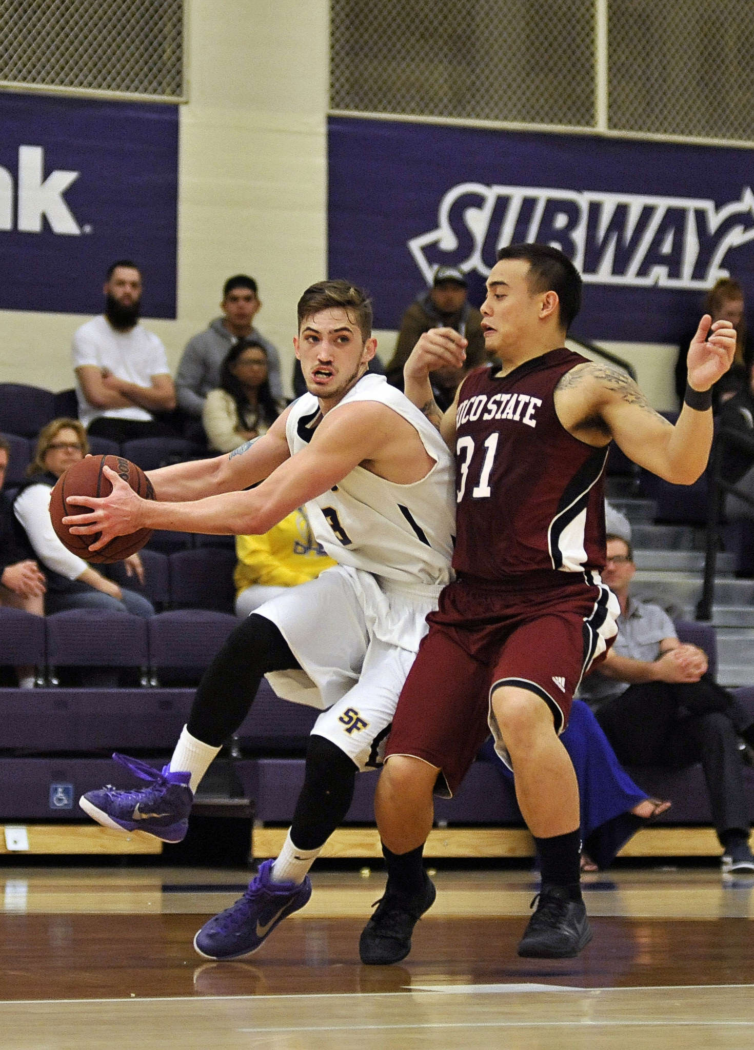 SF State Gators senior Bren Haley (#3) dribbles the ball around Chico State Wildcats player Mike Rosaroso (#31) during their game on Feb. 21, 2015. (Sara Gobets / Xpress)