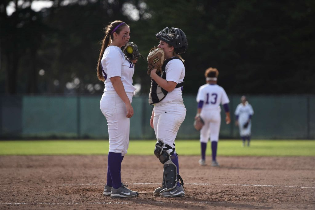Sophomore pitcher Courtney Dunkel and Sophomore catcher Tori Bellin conference on the mound at SFSU Softball Stadium, Feb. 11, 2015.