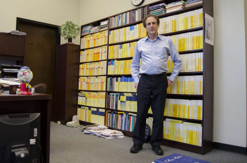 The current dean of the College of Science and Engineering Sheldon Axler stands in the office which will be taken over by his successor in the summer at his office in Robert A. Thornton Hall at SF State Monday, March 16. (Hyunha Kim / Xpress)