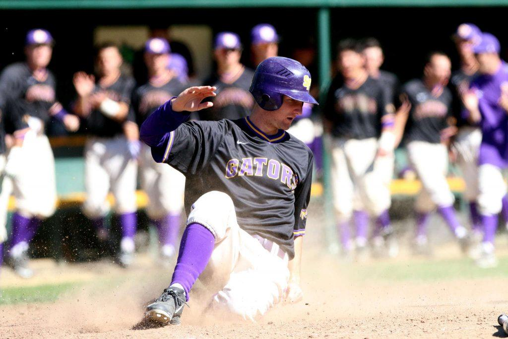 SF State Gator Will Hein (21) slides in for a homerun during Sundays game against Cal State L.A Golden Eagles. (Marlene Sanchez / Xpress)