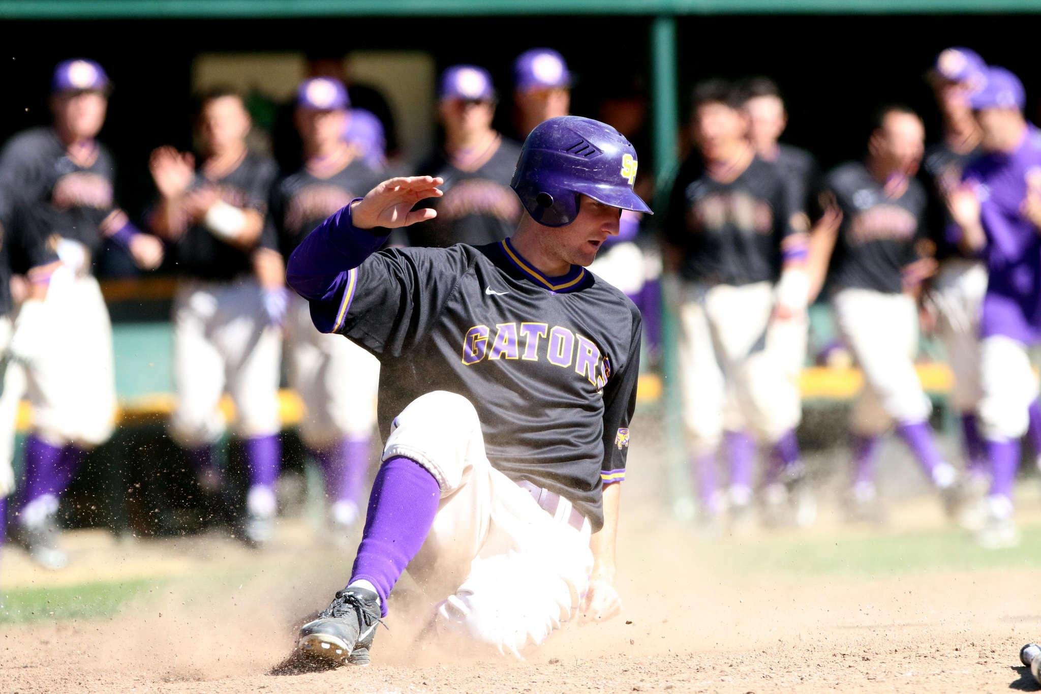 SF State Gator Will Hein (21) slides in for a homerun during Sunday's game against Cal State L.A Golden Eagles. (Marlene Sanchez / Xpress)