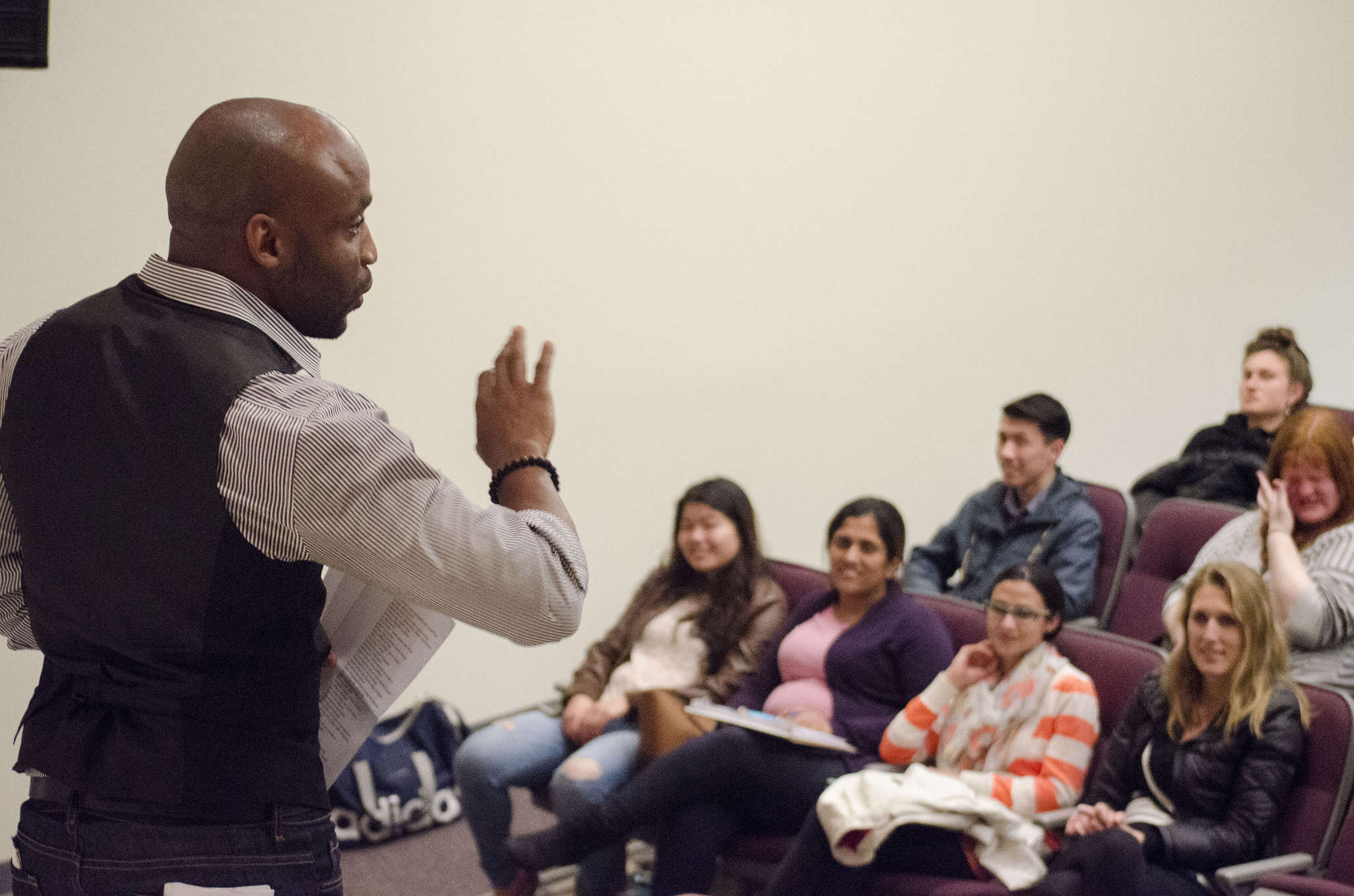 Javon Johnson, an assistant professor of Performance and Communication studies at SF State, recites poetry to a group of students in the Humanities Auditorium Friday, Feb. 26. (Hyunha Kim / Xpress)