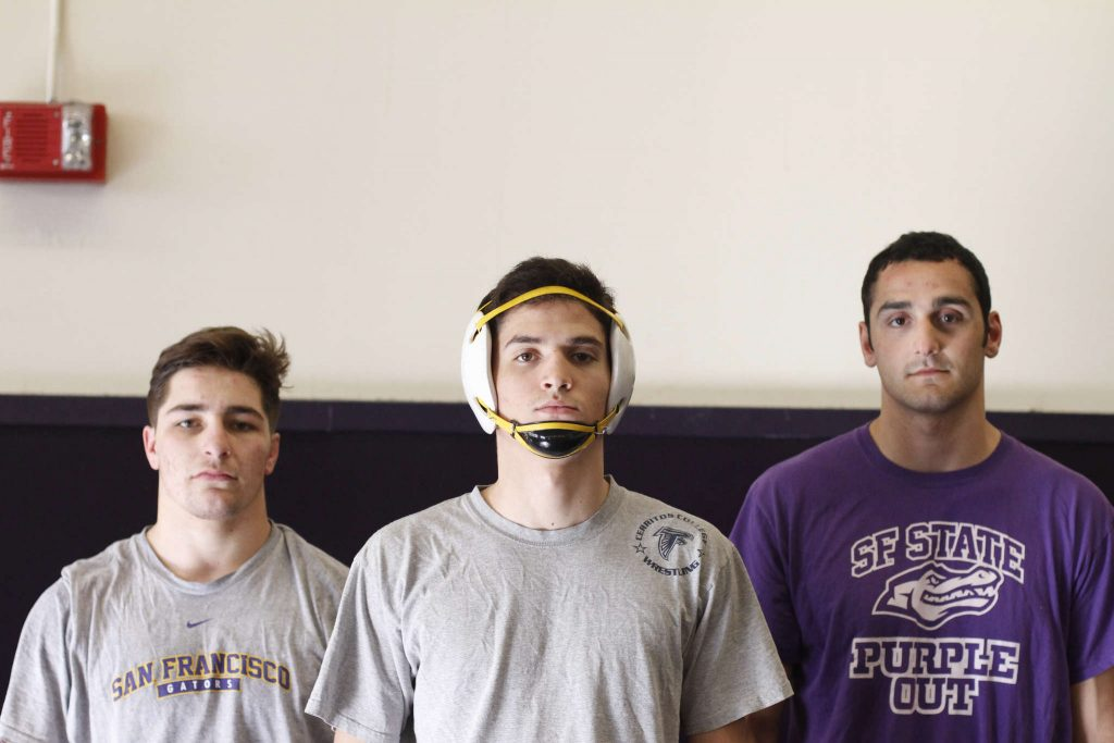 (From left to right) SF State Wrestlers Johnny Costa, Jordan Garrola, Andrew Reggi take a photo after practice Tuesday, March 3. (Angelica Ekeke / Xpress)