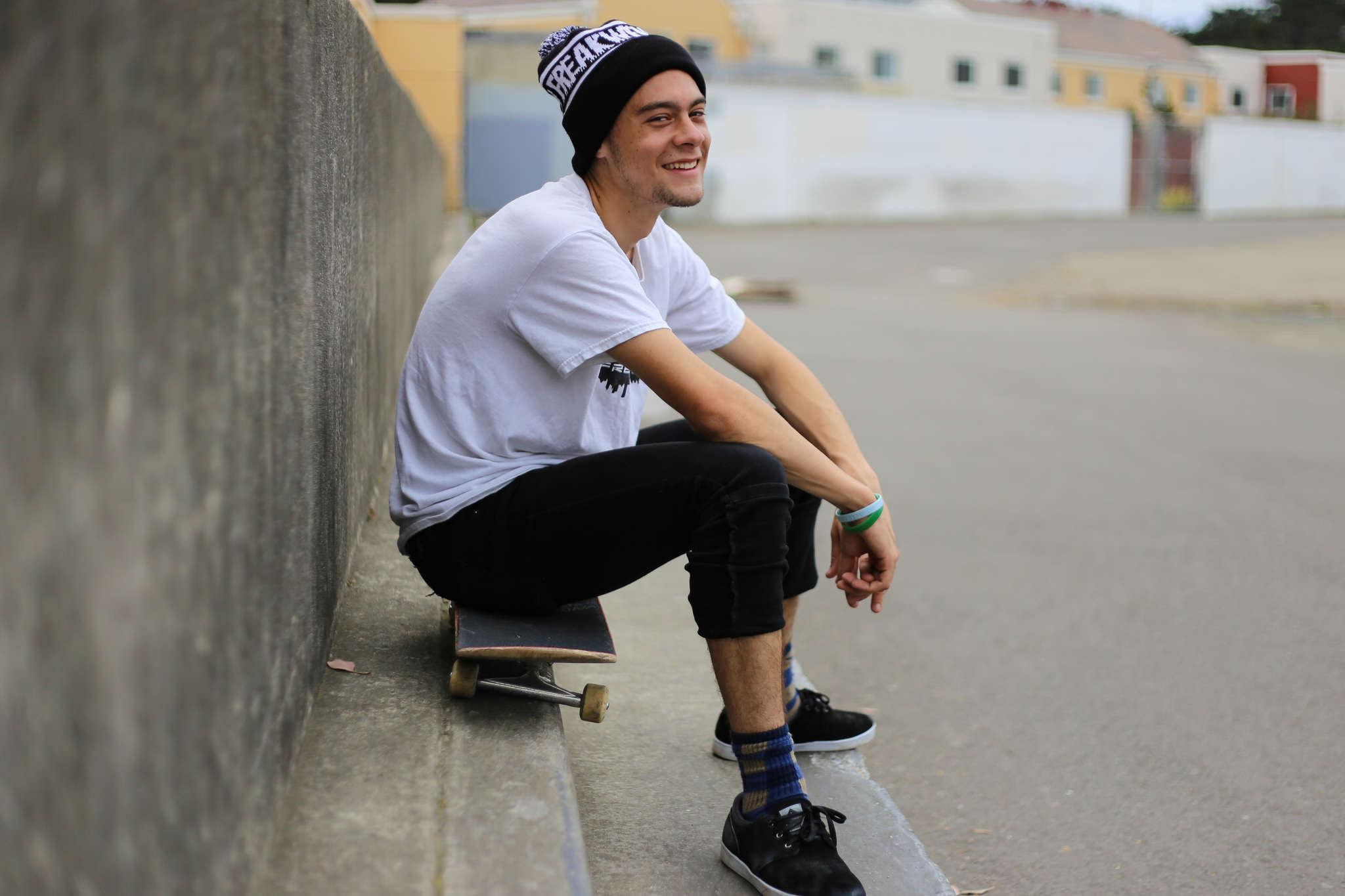 Sam Gershwin, a SF State cinema major and the owner of skate company Freakwency, stops for a portrait at the lowledge; a popular skate spot across from the West Campus Green on Monday, March. 16, 2015. (Kate Fraser / Xpress)