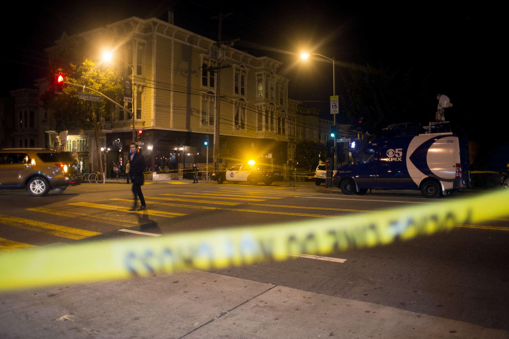 Police respond to a bomb threat on Bartlett Street between 22nd and 23rd streets in the Mission District on Friday February 27, 2015. People were told to remain situated and residents in the surrounding area evacuated their homes. Police cleared the scene at about 10:45pm. (Emma Chiang / Xpress)