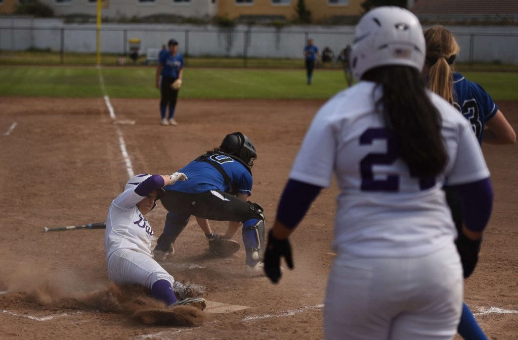 Junior shortstop Jennifer Lewis scores in game two of a doubleheader against Cal State San Bernardino at SFSU Softball Field Friday, March 20 (David Henry / Xpress)
