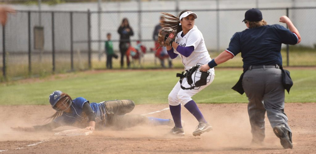 SF State Gator infielder Lucy Fernandez tags a Cal State San Bernardino runner out at third base in game one of a doubleheader at SFSU Softball Field Friday, March 20. (David Henry / Xpress)