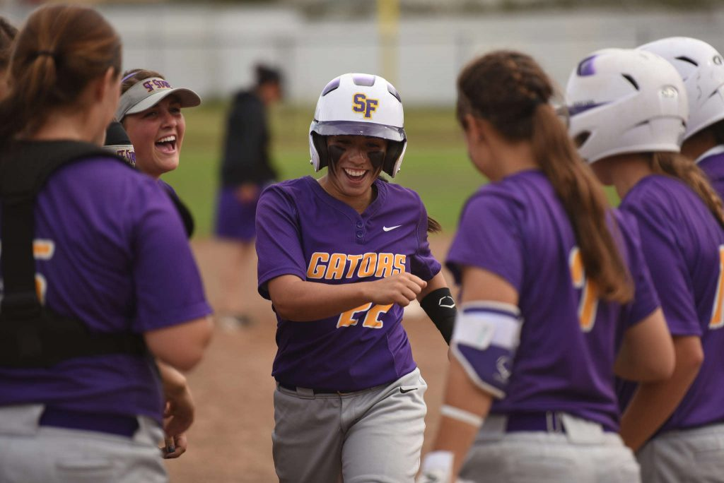 Sophomore outfielder Aryn Guzman trots home after hitting a home run in game two of a doubleheader against Holy Names University at SFSU Softball Field, Friday, March 13, 2015. (David Henry / Xpress)