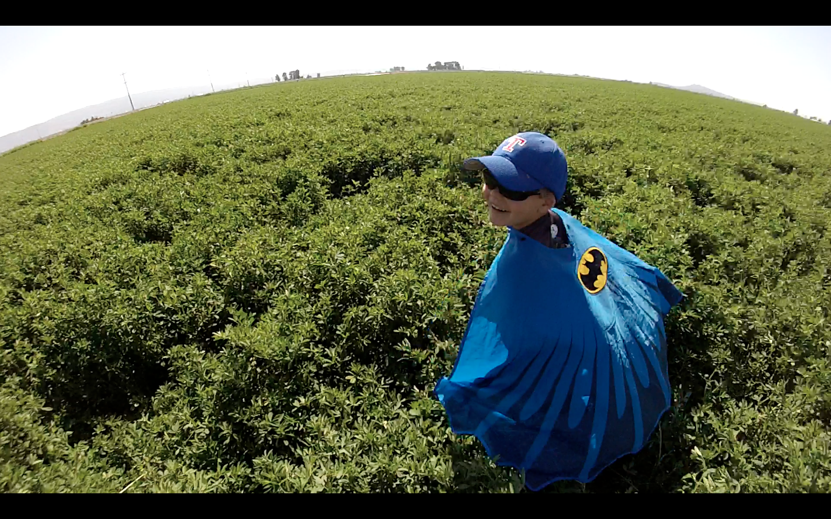 Miles Scott plays in a field while filming the documentary. (KTF Films / Courtesy to Xpress)