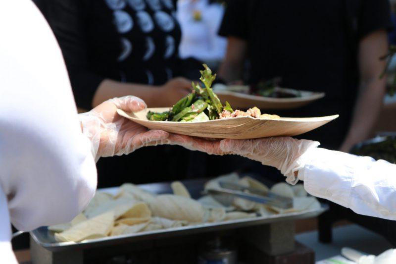 Food is being served at the Farm to Fork event by the Office of Sustainability and Chartwells in the Quad on Thursday April 16. (Marlene Sanchez / Xpress)