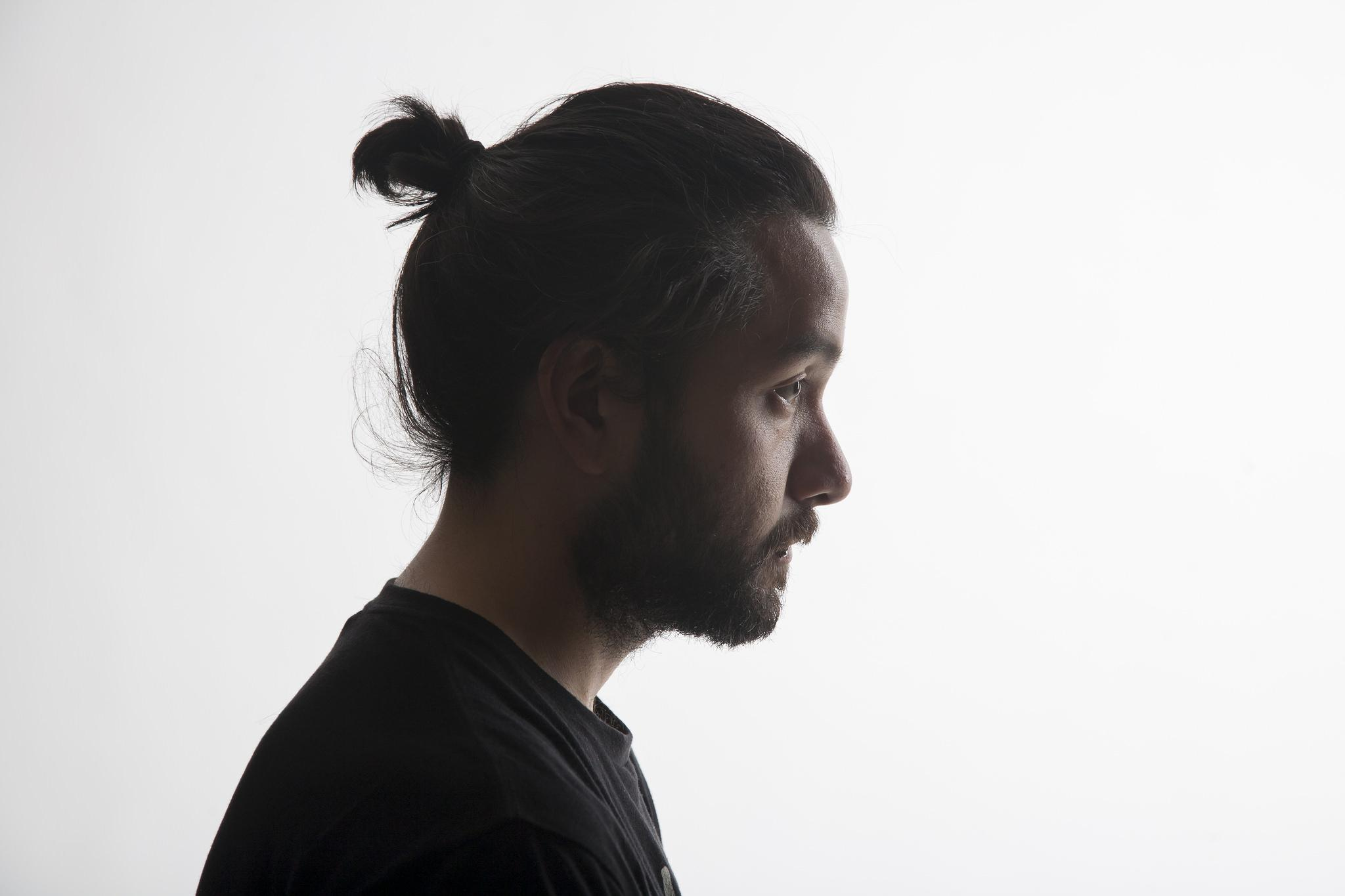Golden Gate Xpress photo editor, Daniel Porter, sports his mini man bun Mon. April 27. (Martin Bustamante / Xpress)