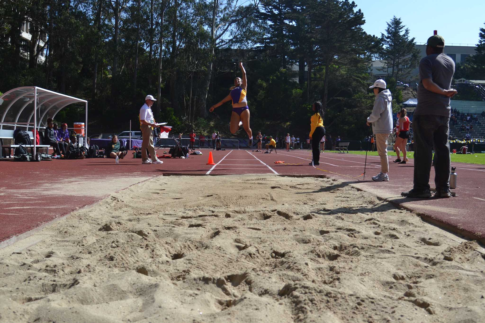 Graduating criminal justice major and record setting athlete, Hilary King, jumps 5.79 meters, in the long jump, taking first place at Cox Stadium Friday, April 3. She recently broke the Women's record at SFSU by jumping 5.79 meters. (Helen Tinna / Xpress)