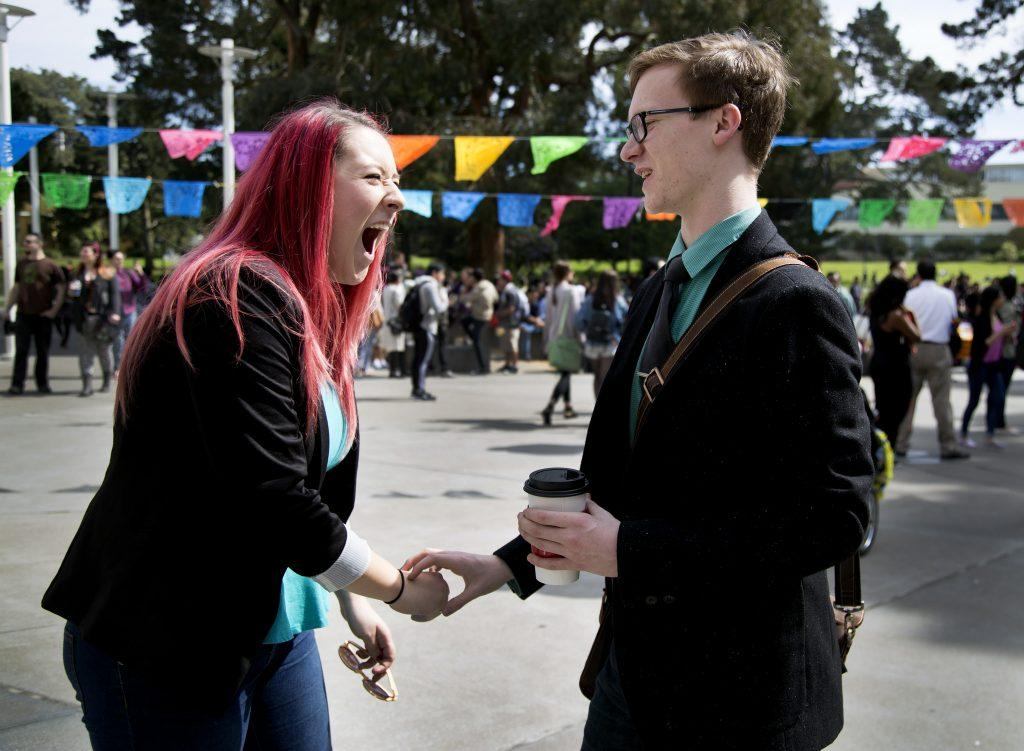 Sarah Pishny, left, VP of internal affairs and political science major talks with Forest Klein, right, liberal and creative arts representative, both ASI candidates for next semester, Fall 2015 in the Malcolm X Plaza on Thursday March 19. (Emma Chiang / Xpress)
