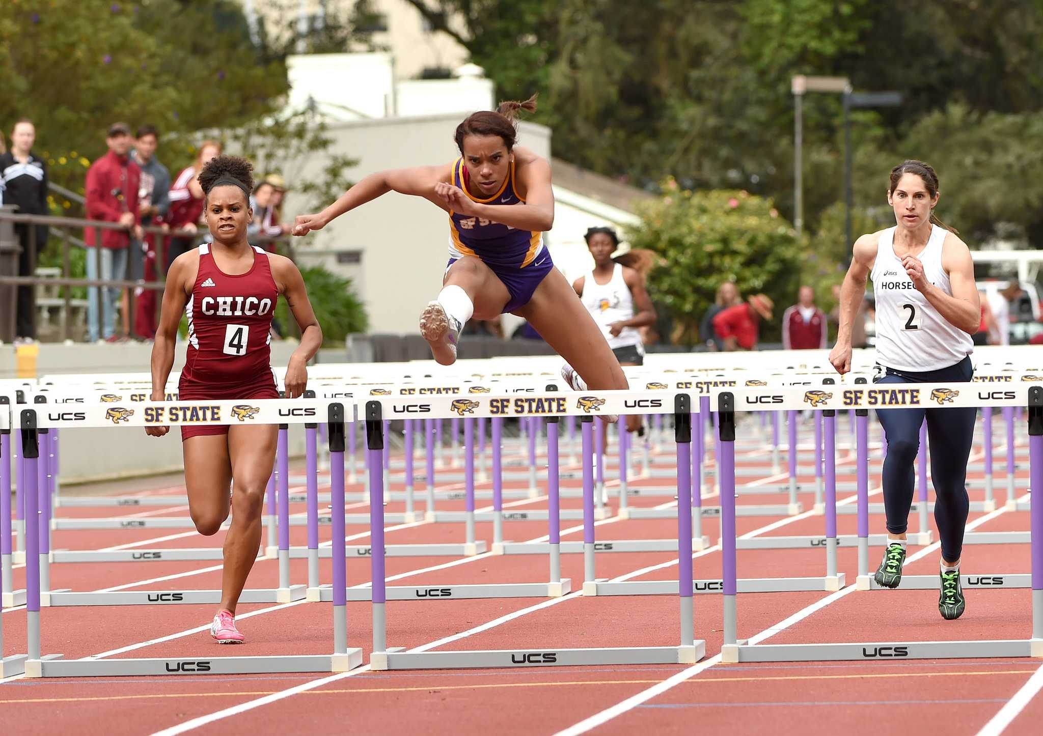 SF State Gator Laura Stokes jumps hurdles during the Johnny Mathis Invitational at Cox Stadium Saturday, March 21. (Courtesy of SF State Athletics / Gerome Wright)