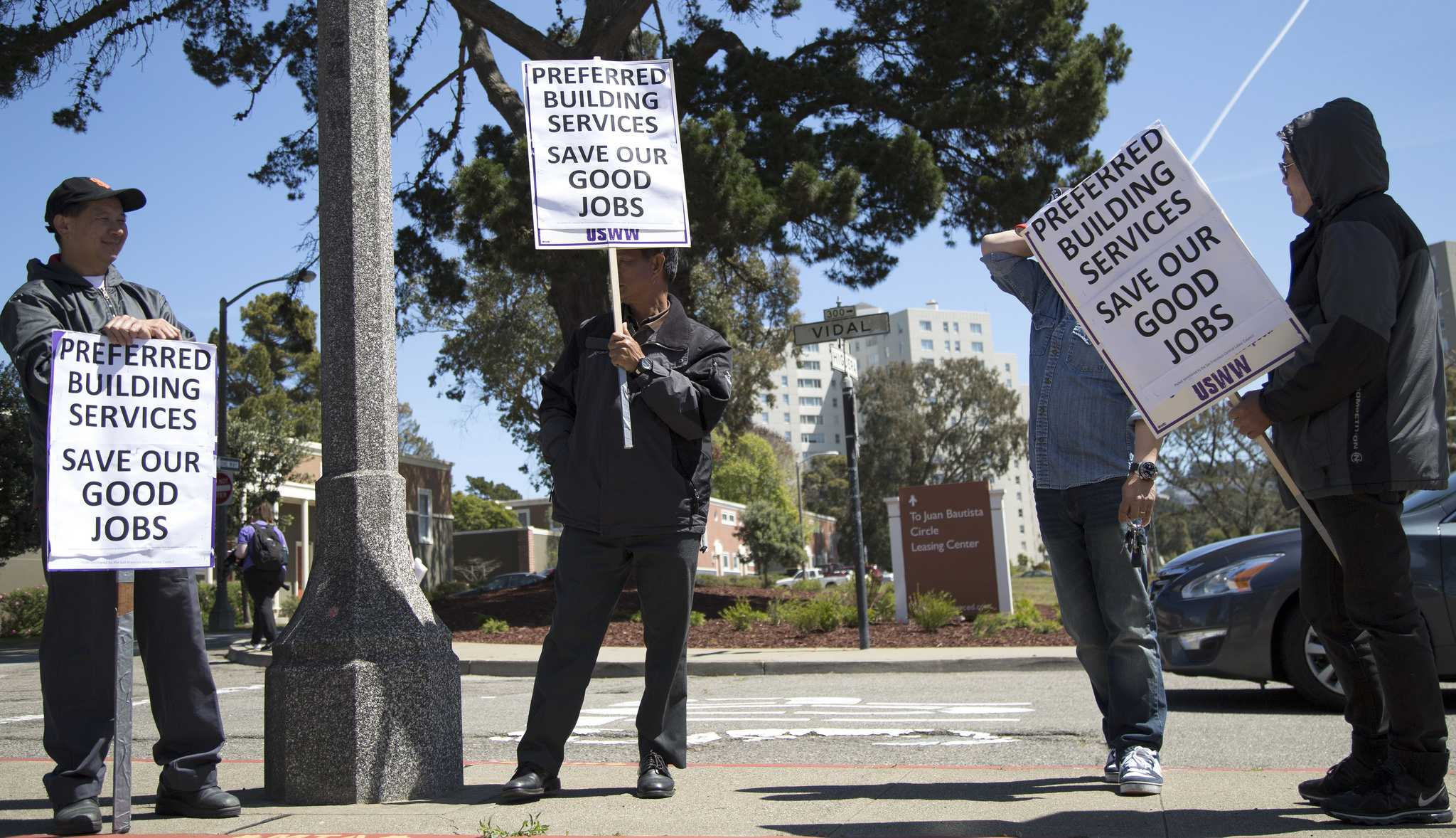 Villas Park Merced janitors and handymen picket around Park Merced on Wednesday April 15. They have been terminated and a new crew of janitors by a new contractor will be hired. (Emma Chiang  / Xpress)