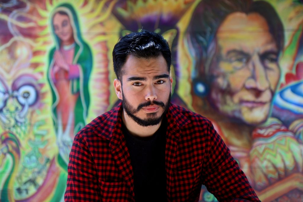 Sergio Portela poses for a portrait at Balmy Alley in the Mission District on Tuesday April 14. (Marlene Sanchez / Xpress)
