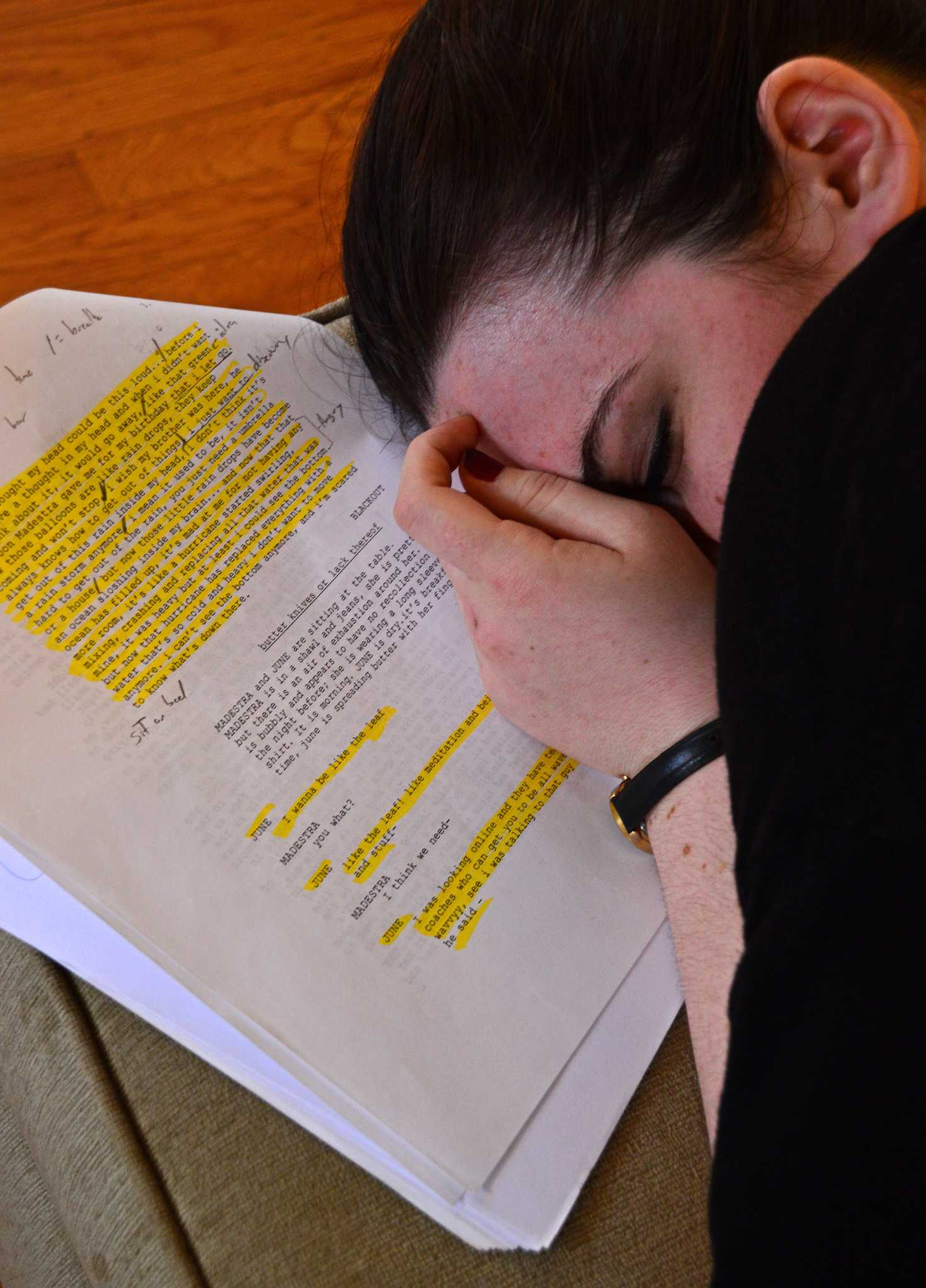 """Theater major Jennifer Marte sleeps for her scene as a few of the cast members they rehearse Sunday, April 19. The upcoming play called """"Puddles"""" will be performed at the Greenhouse Festival Saturday, April 25. (Katie Lewellyn / Xpress)"""