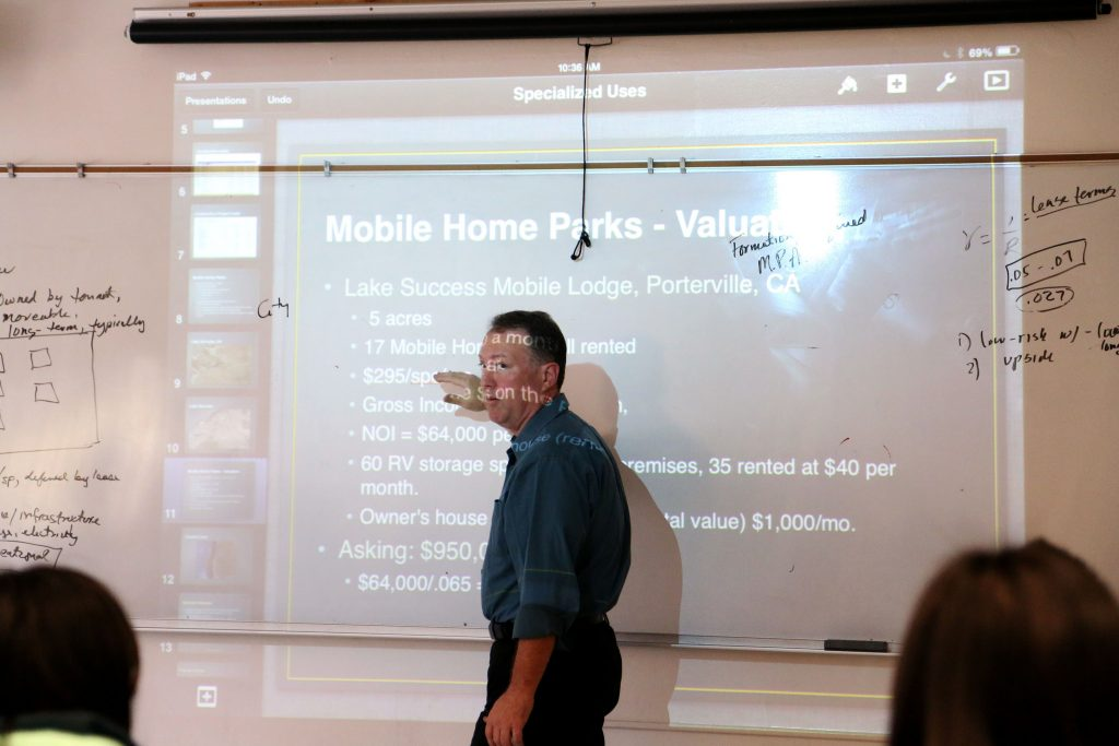 David Hysinger teaches his Fundamentals in Real Estate class in the Business Building Monday, April 6. (Marlene Sanchez / Xpress)