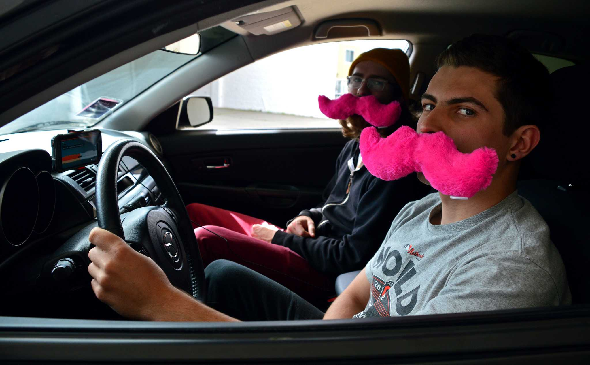 (from right) SF State student drivers Cody Lee, Lyft, and James Shumate, Lyft and Uber, sit in Lee's car which he uses to pick up passengers for work Monday, April 4. (Katie Lewellyn / Xpress)