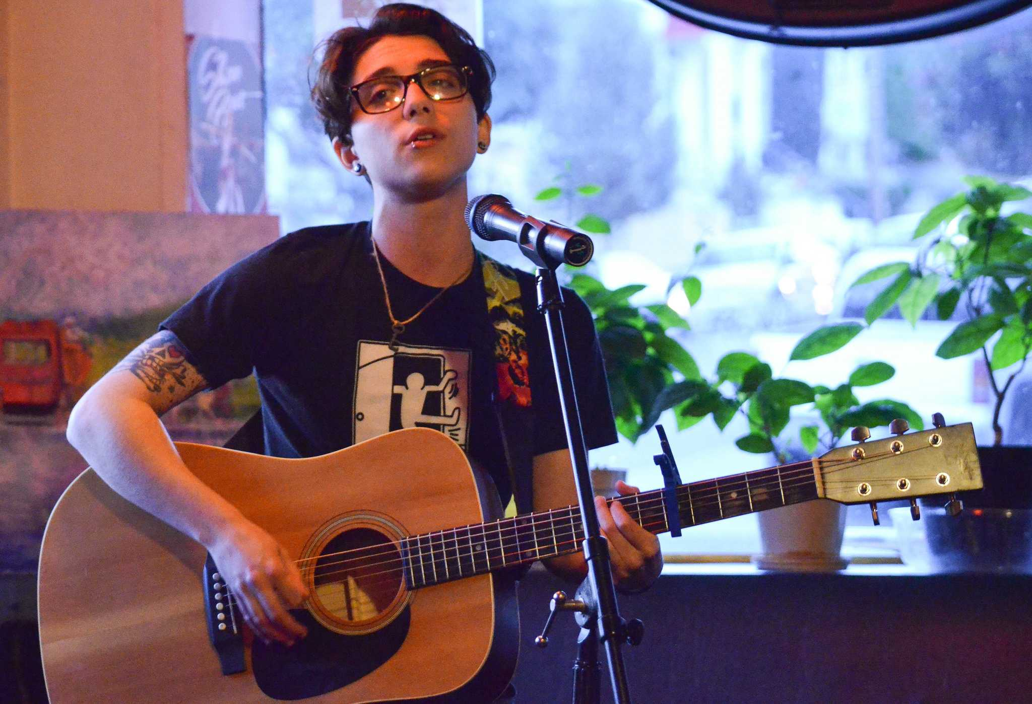 Ryan Cassata performs two songs at the Sacred Grounds Cafe open mic on Thursday April 9. (Melissa Minton / Xpress)