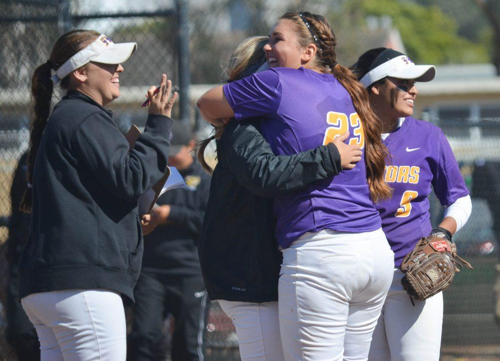 The SF State softball team celebrates after winning the second game of the doubleheader against Cal State East Bay at the Softball Field on Saturday, April 25. (Melissa Minton / Xpress)