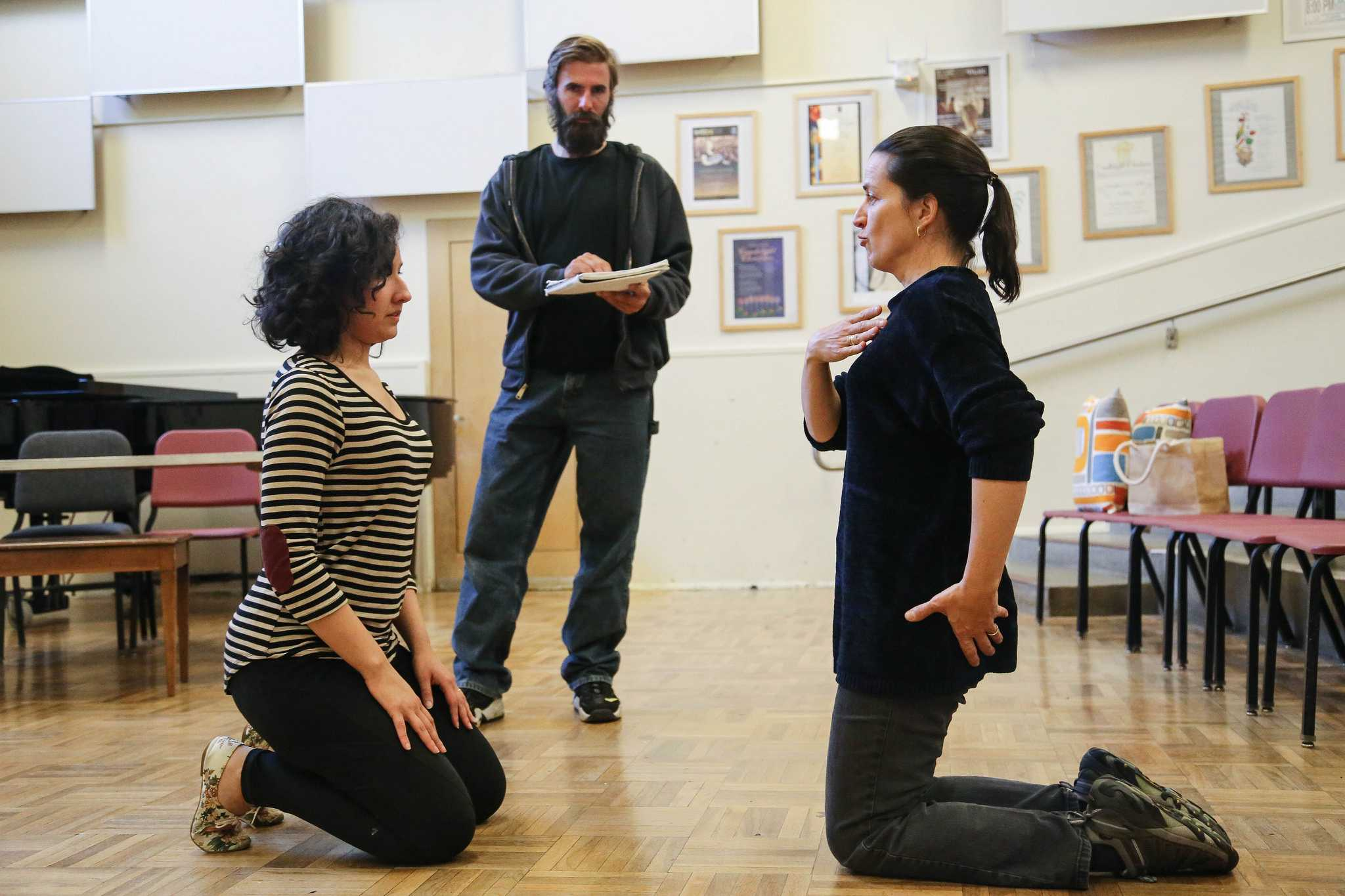 Christine Brandes (right), voice teacher, directs dance student Nadia Endara at rehearsals for
