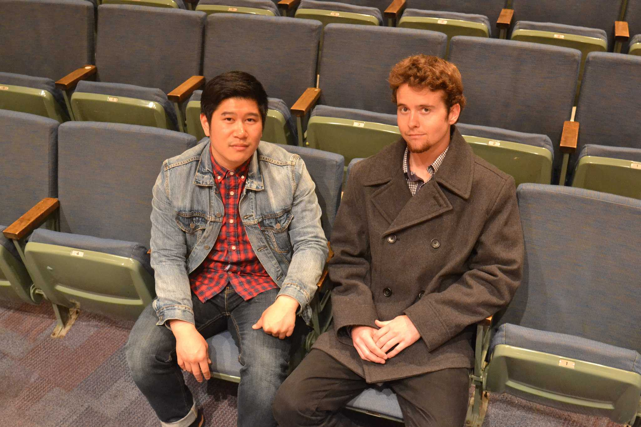 SF State student and co-director of CockTales, Vincent Lam (left) sits with Nathan Barone for a portrait in a theater on campus on Tuesday, April 21.  Barone will perform a spoken word piece in the production CockTales. (Helen Tinna / Xpress)