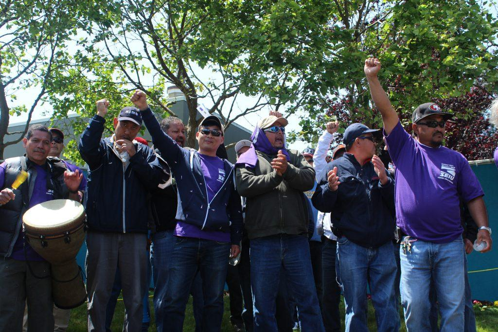 Former Park Merced janitors and handymen who have been terminated two weeks prior rally in front of the Park Merced leasing office Thursday, April 23. (Angeline Ubaldo / Xpress)
